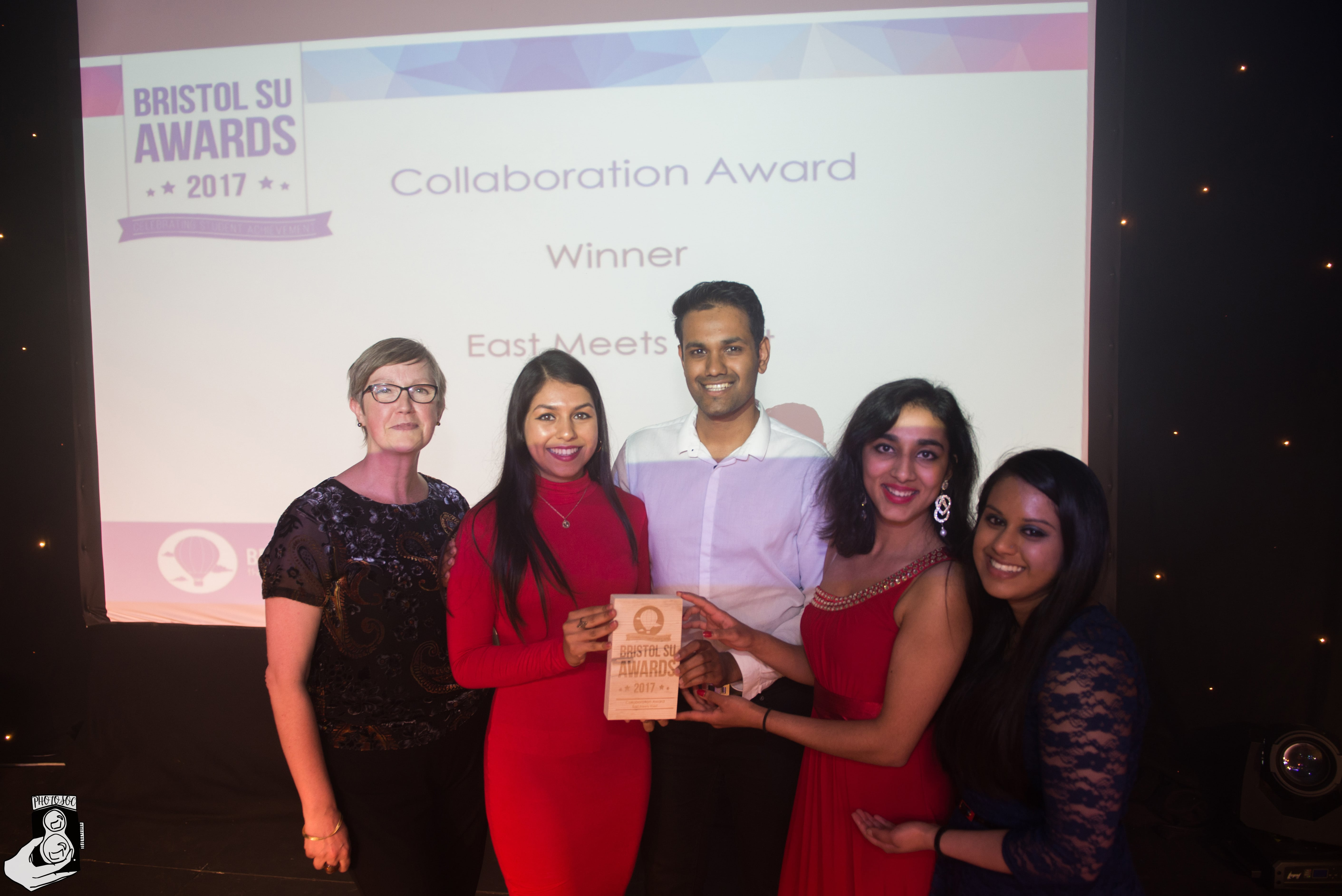 members of East Meets West winning collaboration award
