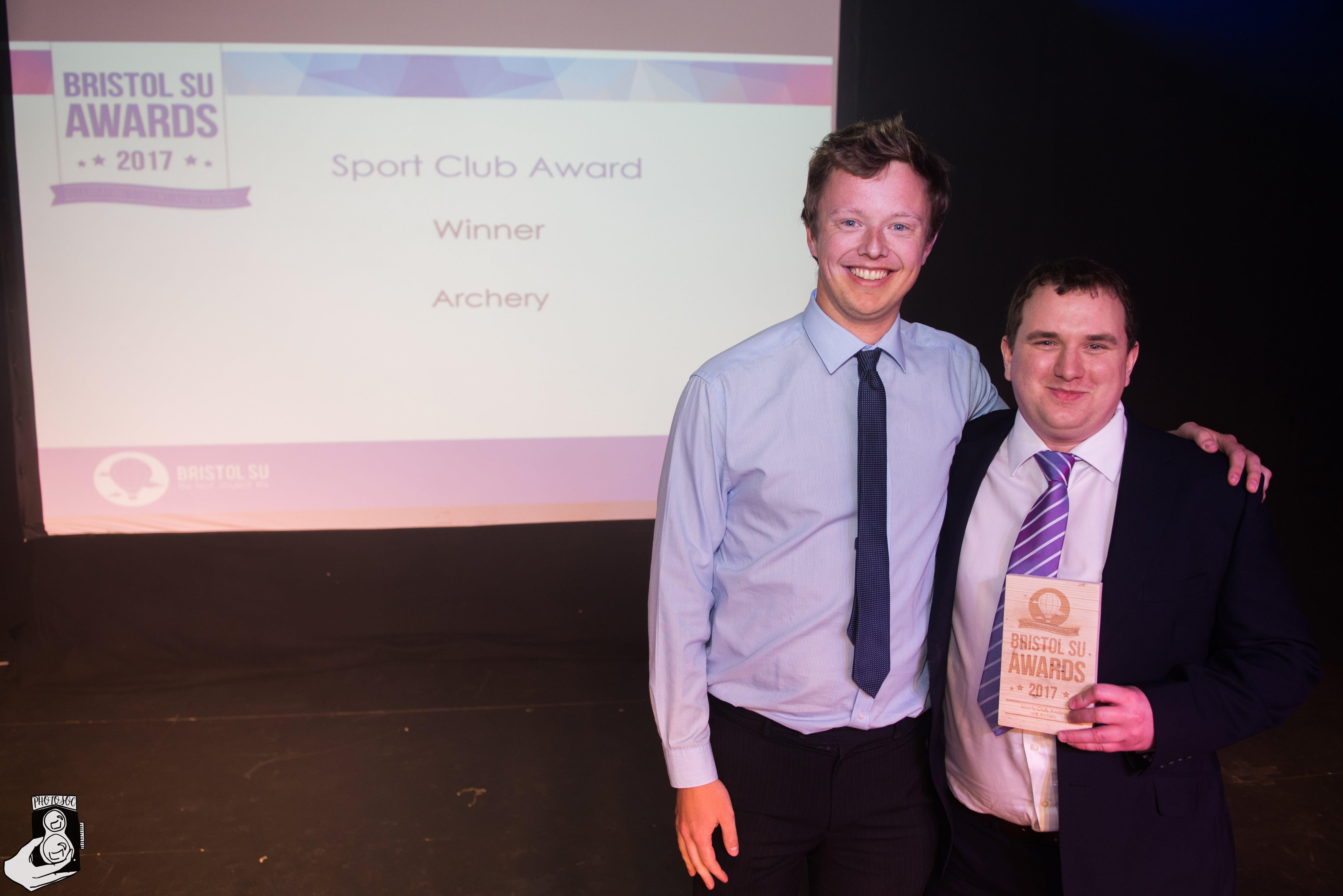 Archery rep accepting sports club award