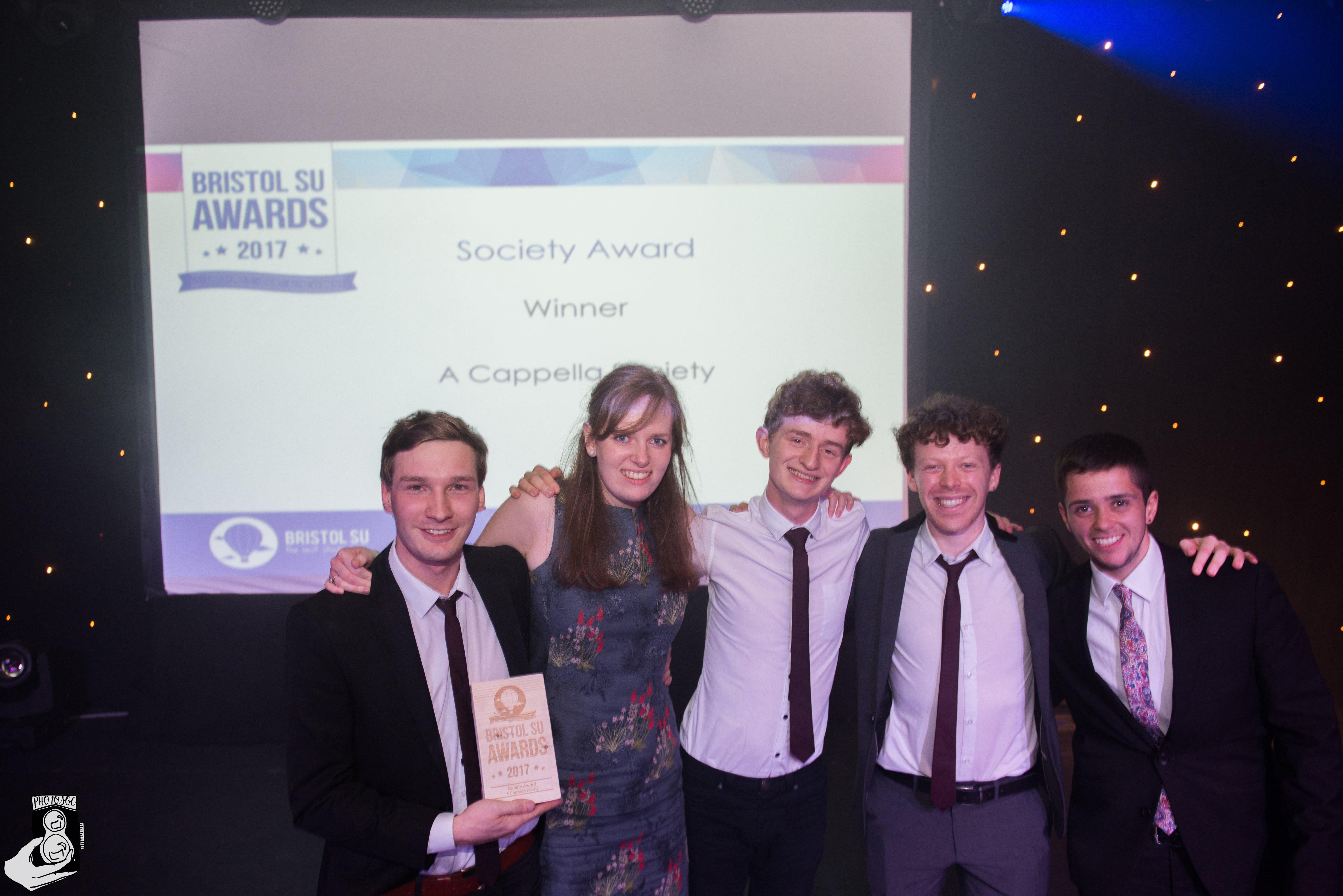 Members of A Cappella Society accepting society award