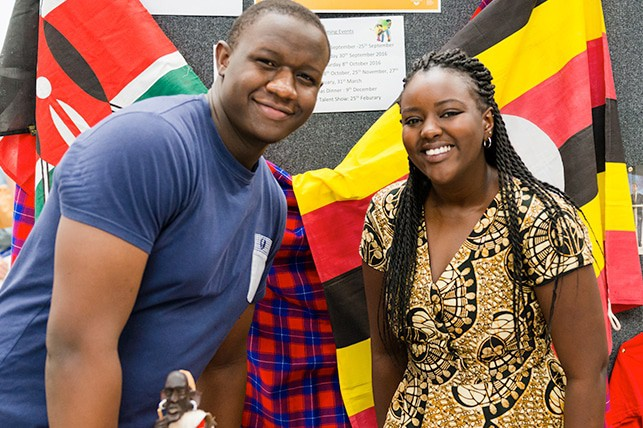 Two people at the societies fair.