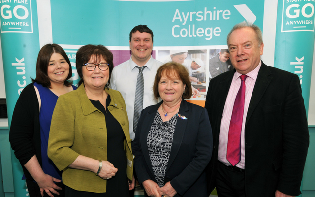 Minister for Mental Health Maureen Watt joins NUS Scotland President Luke Humberstone, President of Ayshire College Students' Association and NUS Scotland Disabled Students' Officer Lainey McKinlay, Ayshire College Principal Heather Dunk OBE and Ayshire College Chair Willie Mackie for the funding announcement