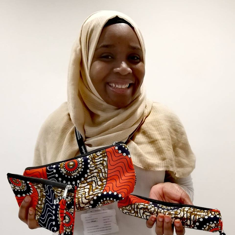 Ruky Yussuf holding Shika pencil cases in 3 different sizes