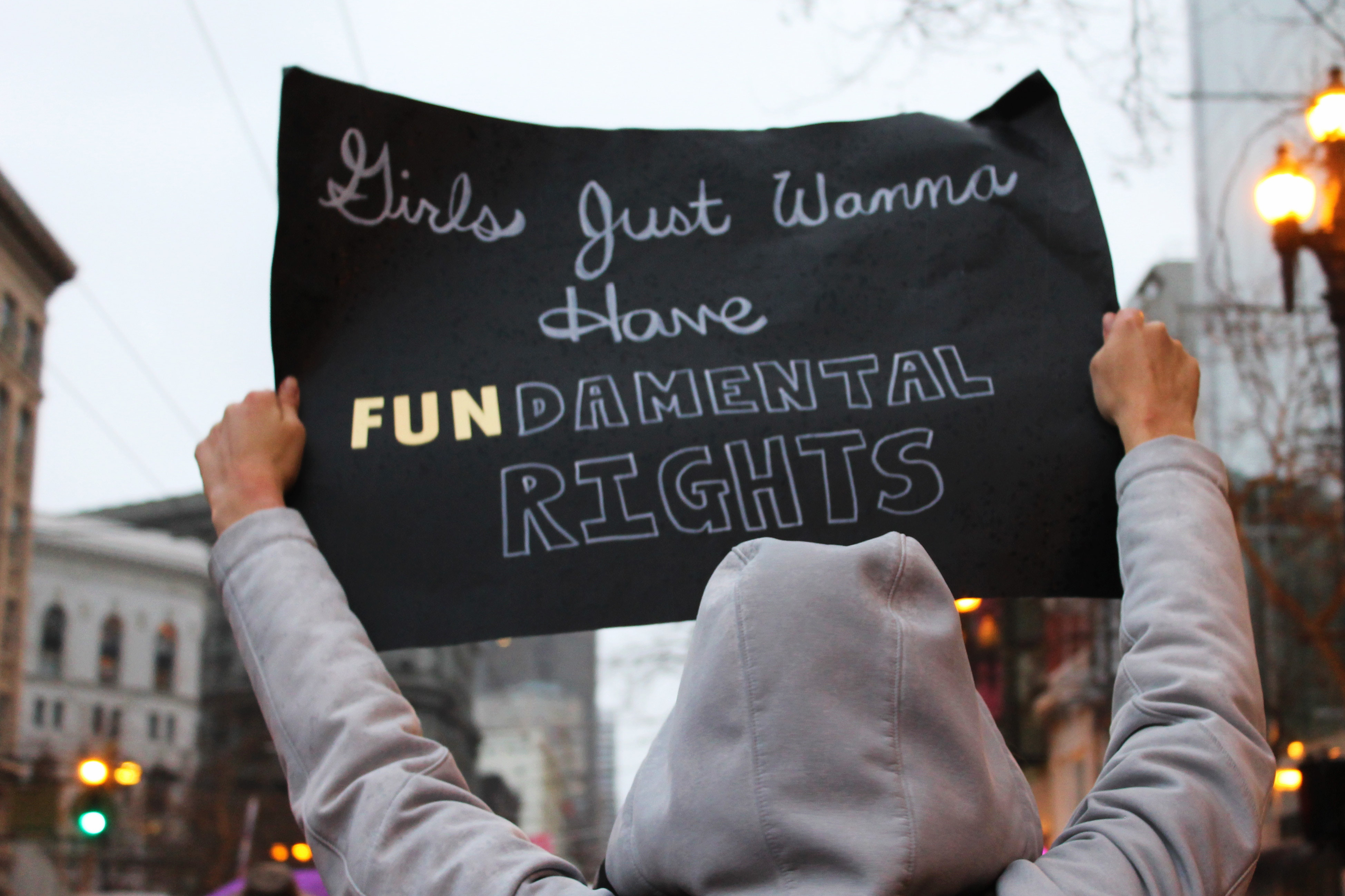 A sign at a protest saying 'girls just wanna have fundamental human rights.'