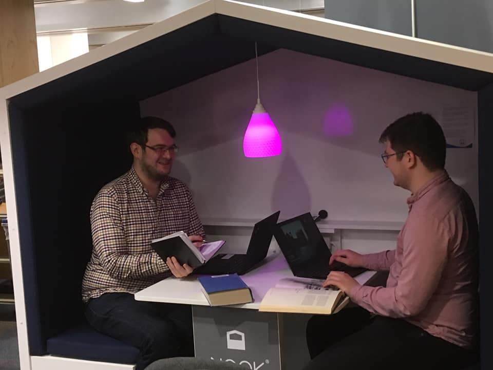 David and Saul sat in library working space shaped like a house