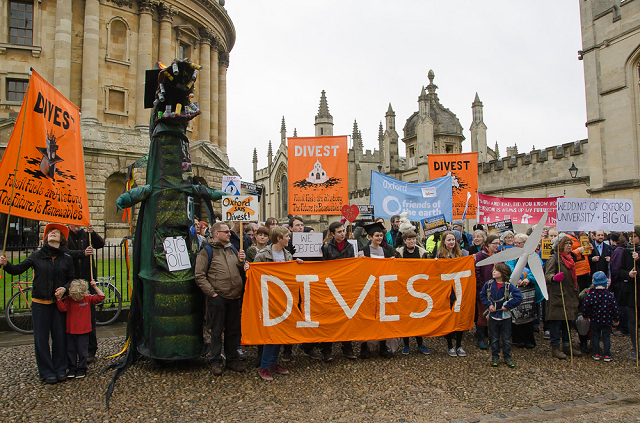 Group of people protesting for divestment with banners