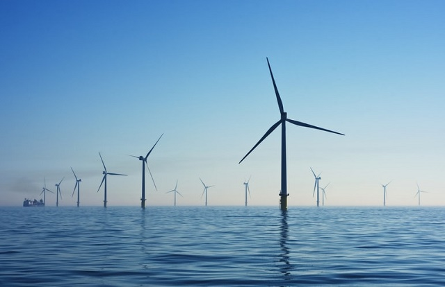 Offshore wind turbines against a clear blue sky