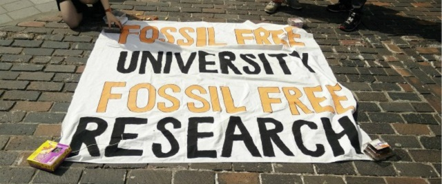 Sign saying Fossil Free University, Fossil Free Research