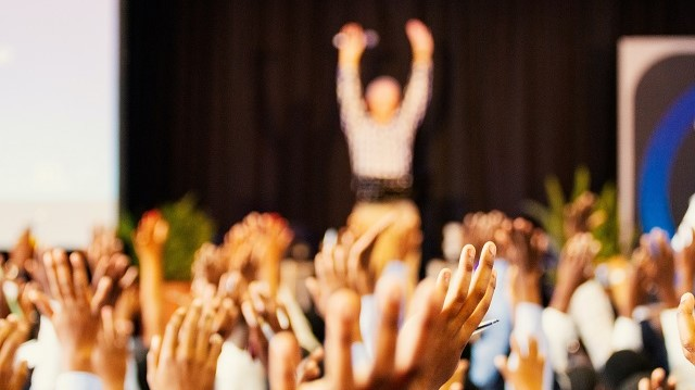 Blurred hands waving in the air