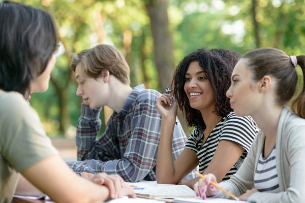 happy students talking across table