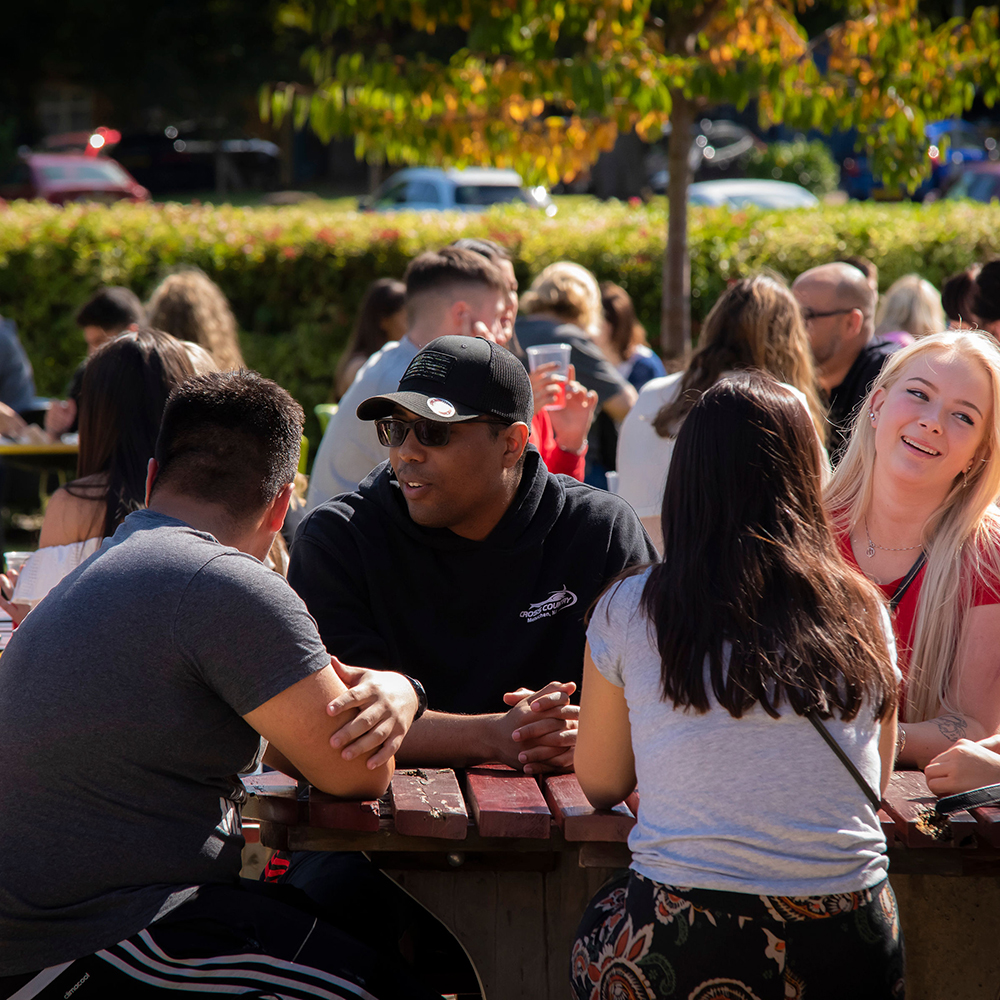 Students sitting outside the St Mary's University Bar on move-in day