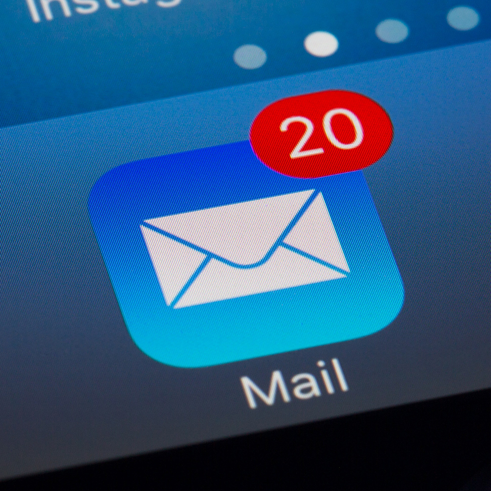 A phone screen showing an email app with 20 new messages on it