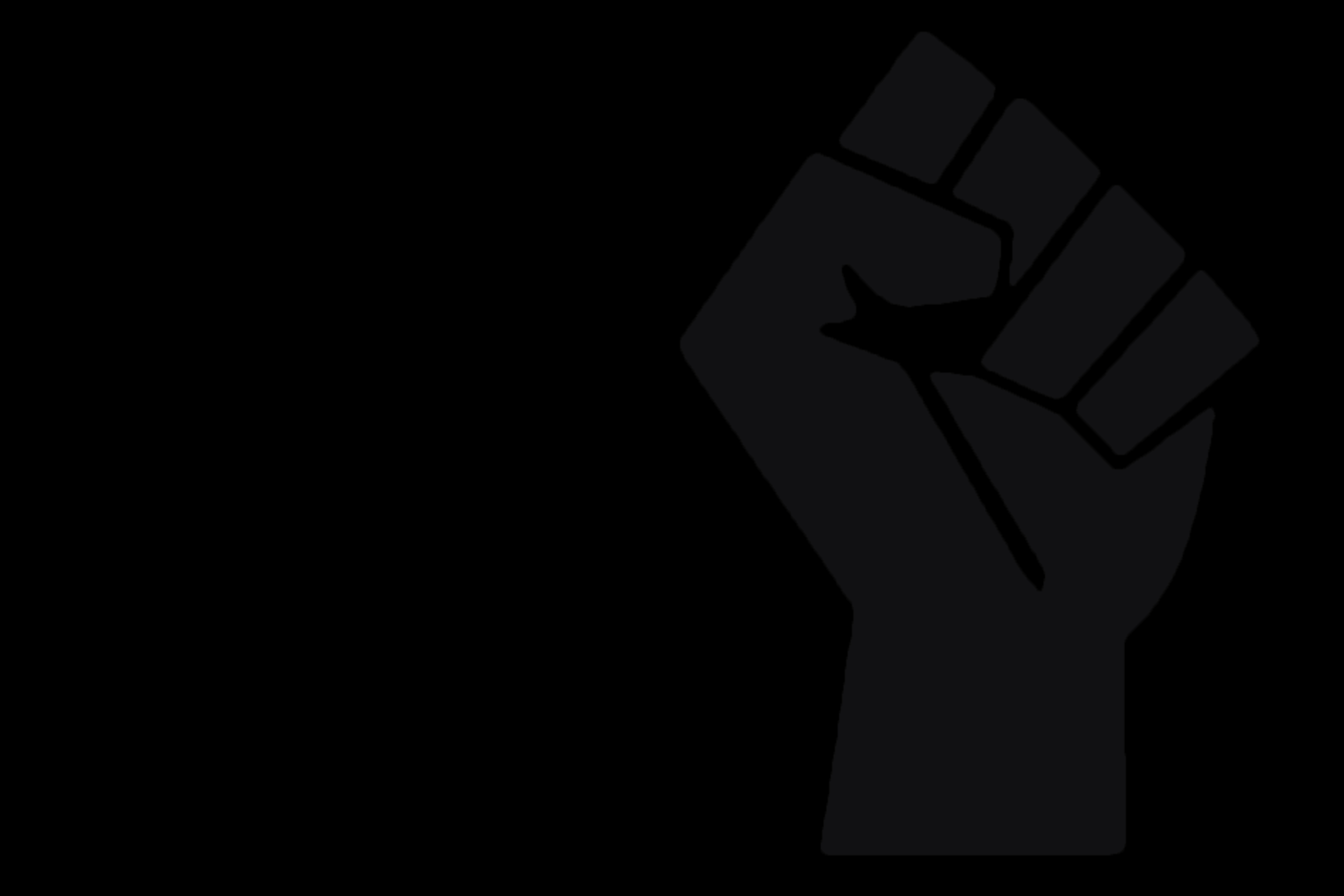 A fist held in the 'black power' salute