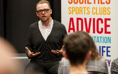 Image of Simon Pegg delivering a lecture to Bristol students