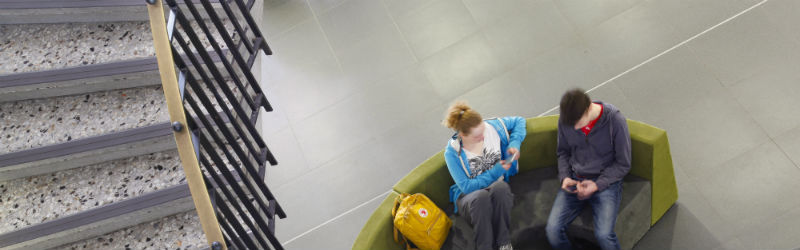 Image of students sitting in richmond building foyer