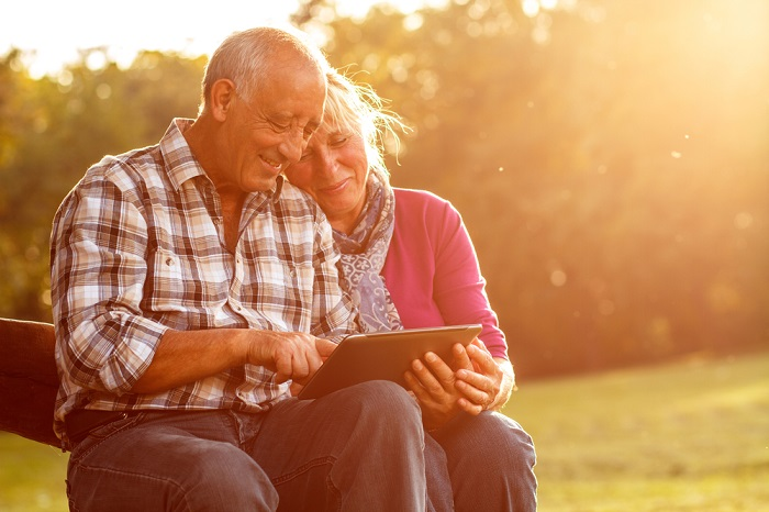 Retired couple with iPad
