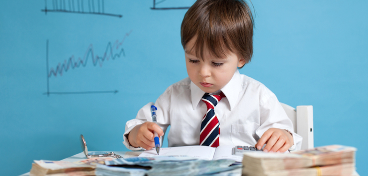 Image of a young boy calculating returns