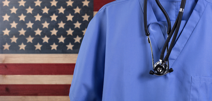 American flag with medical scrubs and stethoscope