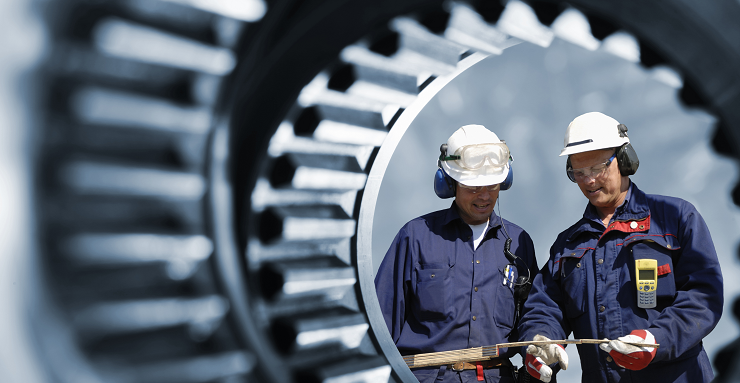 Two engineers working seen through equipment