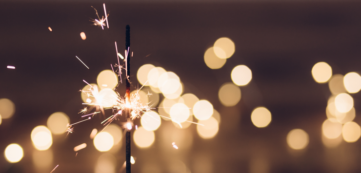 Photo of sparkler sparkling with light flares
