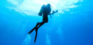 Image of scuba diver underwater rising towards surface