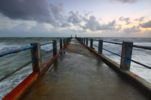 Pier out into stormy seas