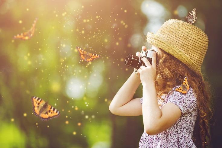 Girl photographing butterflies
