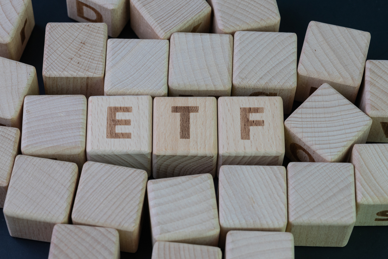 Cube wooden blocks with alphabet to stand for exchange-traded fund, the ETF industry.