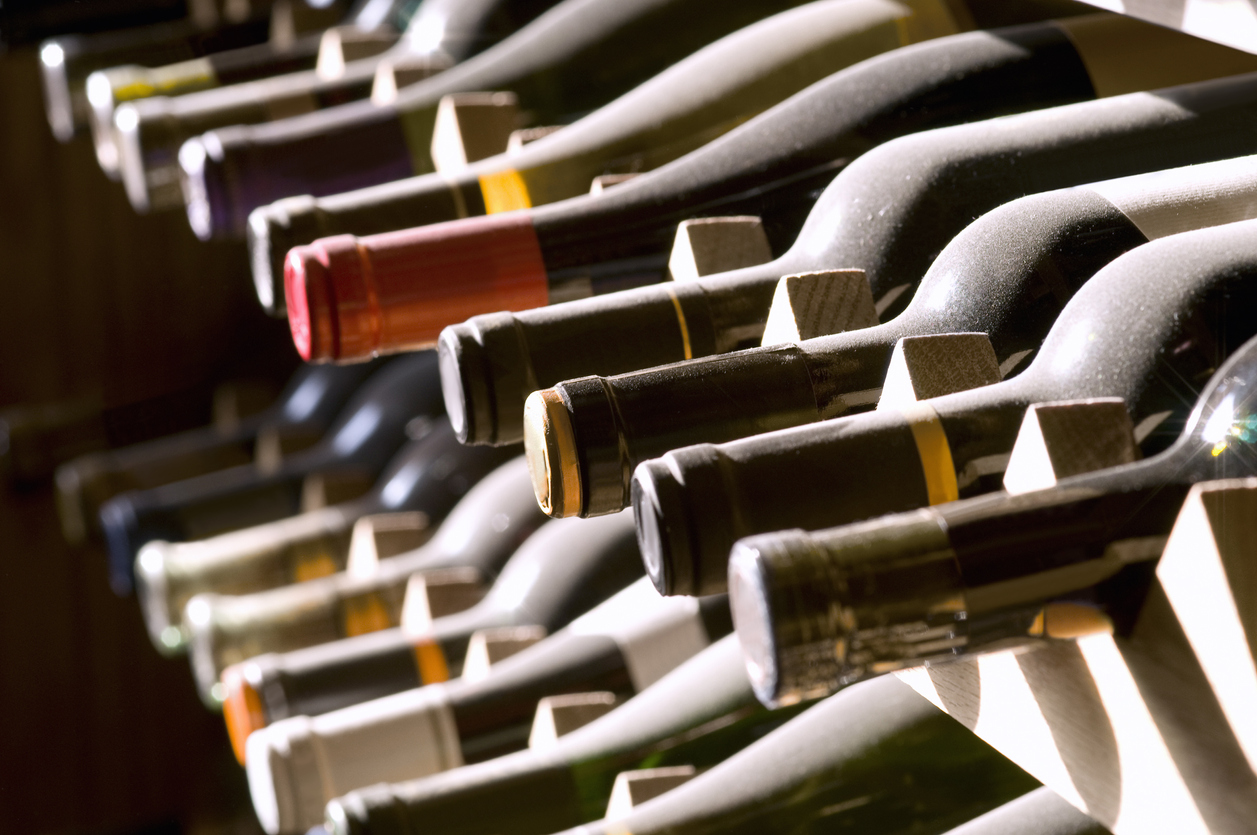 Wine bottles on a rack - when it comes to wine investing, these are the assets