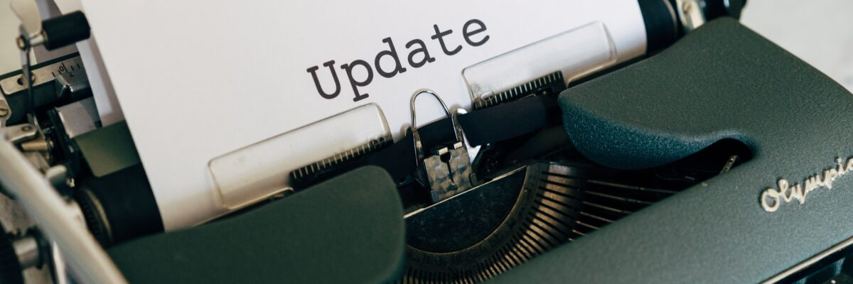 The image shows a typewriter, with a sheet of paper sticking out of the top, the word 'Update' printed in large letters on the paper.