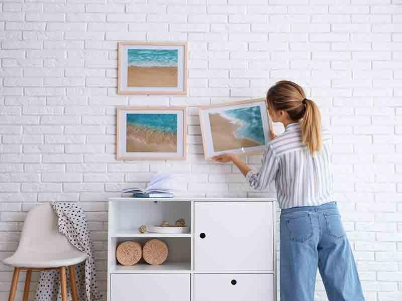 Come appendere i quadri in modo impeccabile