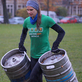 Sara Carrying Kegs at training
