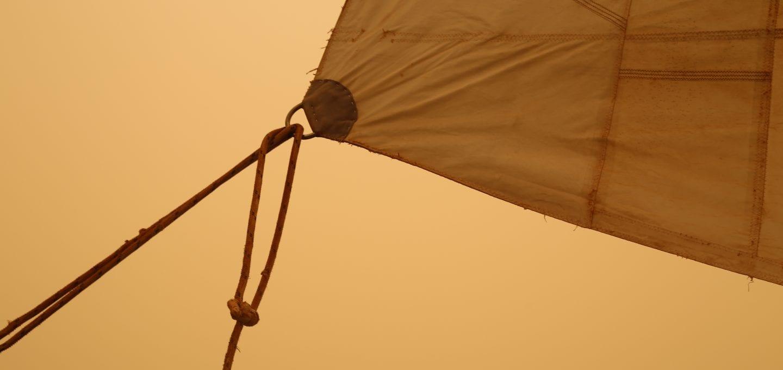 elixir boat ocean sailing sandstorm