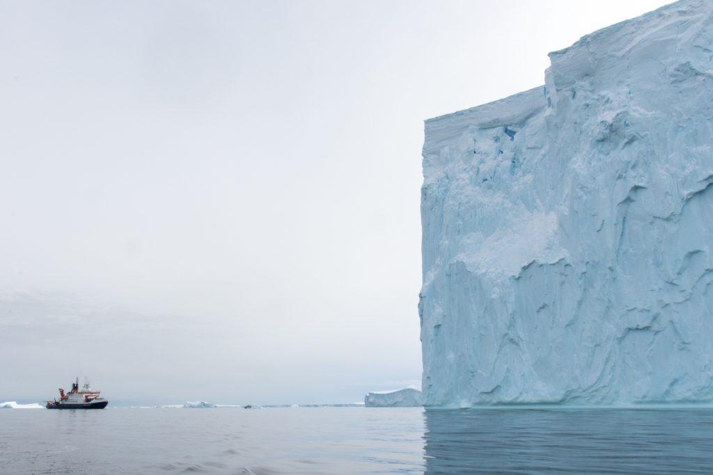 The research vessel Polarstern near an iceberg in Pine Island Bay. (Photo: Thomas Ronge)