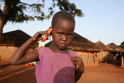 child_with_toy_mobile_phone_uganda.jpg