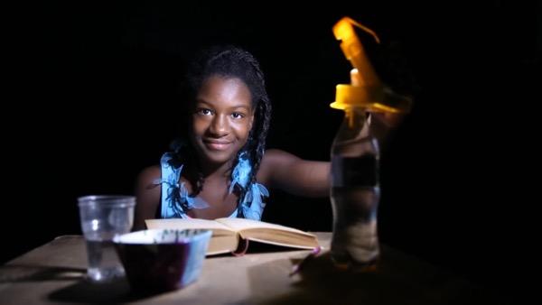 wakawaka-light-haiti-girl-night-reading.jpg