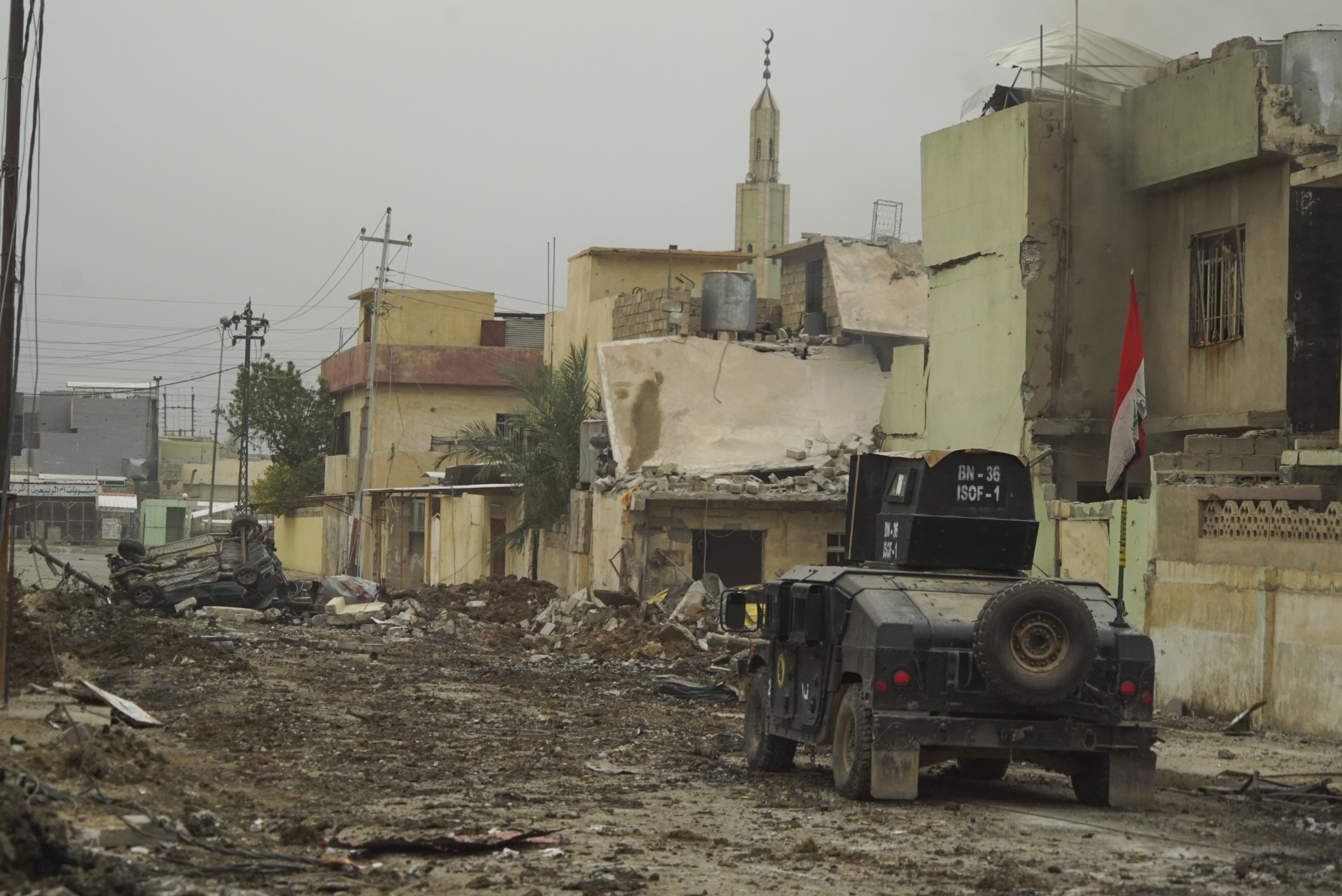 isof_apc_on_the_street_of_mosul_northern_iraq_western_asia._16_november_2016.jpg