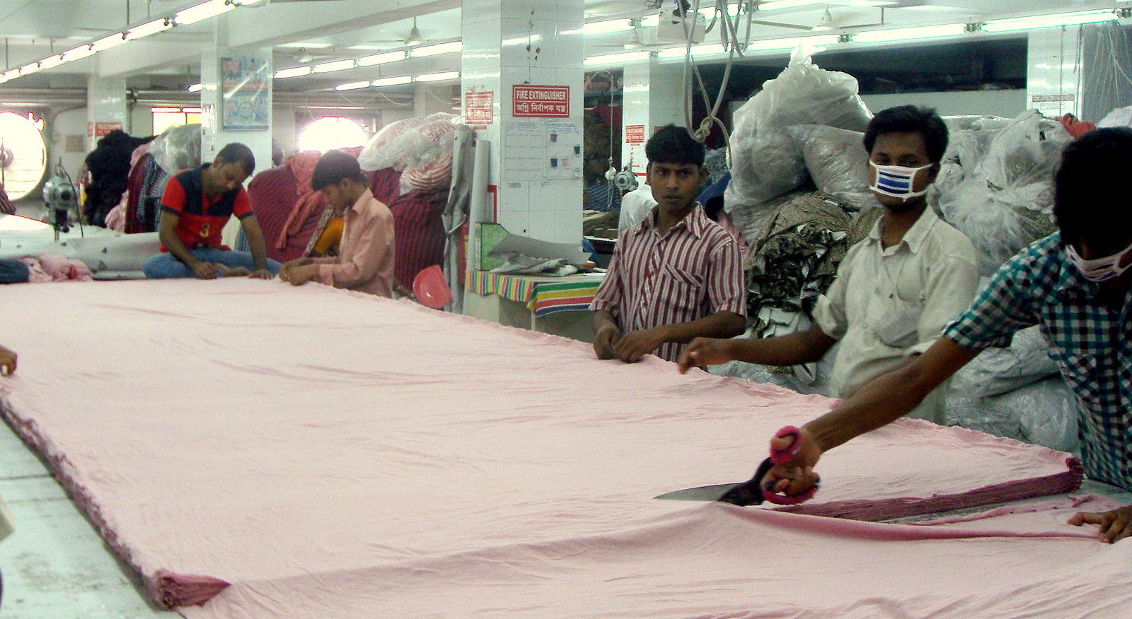 knit_fabric_cutting_in_a_rmg_factory_of_bangladesh.jpg