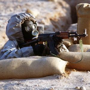 Syrian_soldier_aims_an_AK-47.JPEG