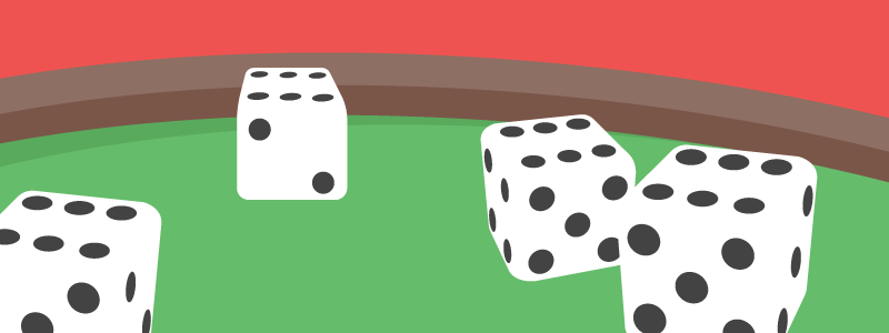 Four dice on green table