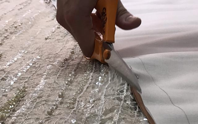 Cutting the fabric for Tosca's Act II costume © Opera North