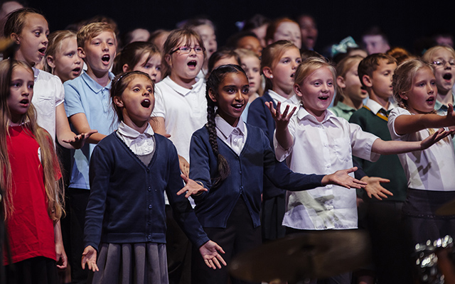 School children perform in the Big Sing in Doncaster in 2017 © James Mulkeen