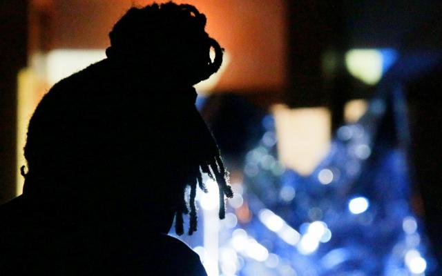 Zimbabwean singer Thabo silhouetted in front of glowing blue visuals during his Resonance residency © Opera North