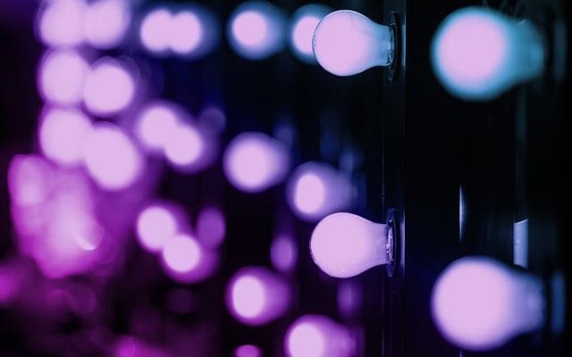 Glowing lightbulbs reminiscent of the stars' dressing room mirror lights