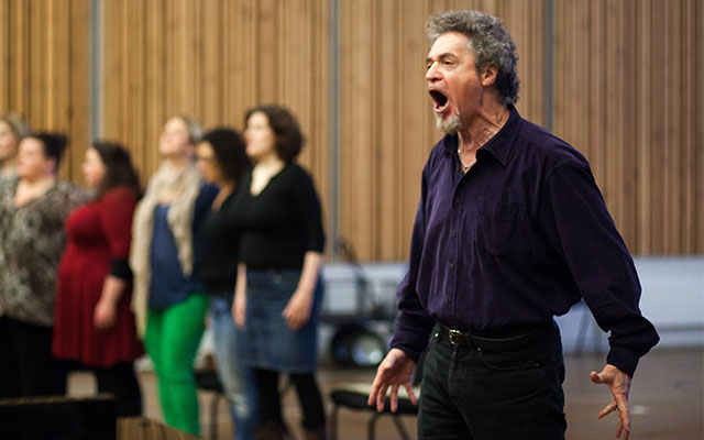 An artists sings passionately at a rehearsal for The Ring Cycle