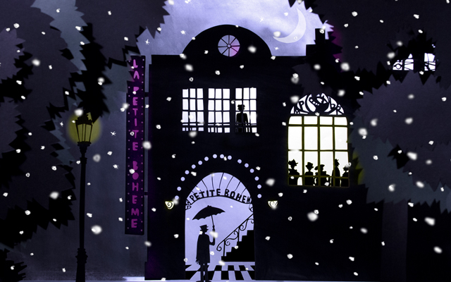 Still from a graphic animation showing a snowy Parisian night scene with a glowing street lamp