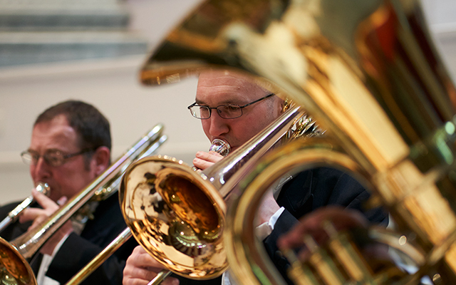 Musicians playing brass instruments in the Orchestra of Opera North