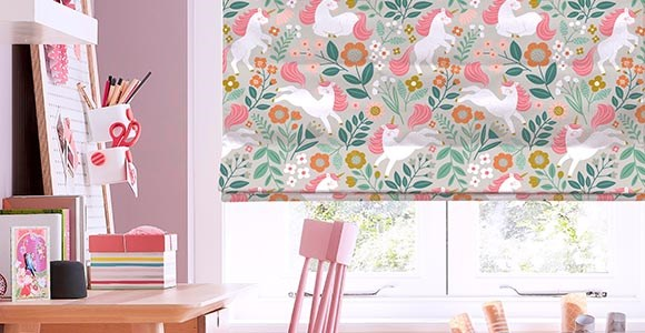 A beautiful collection of stylish children's roman blinds in a variety of cheerful prints.