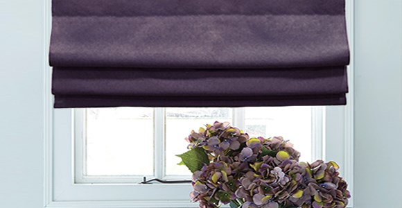 A lovely selection of purple roman blinds in a variety of shades and textures