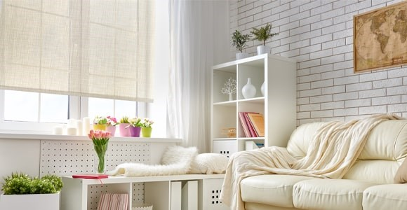 Sunscreen roller blinds are a great solution for blocking the glare of the sun without losing view
