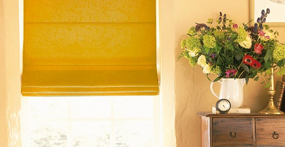 On trend yellow roman blinds in shades of ochre, mustard, sunshine yellow and more